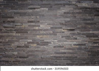 Pattern of black slate wall texture and background