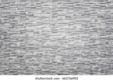Pattern of black slate wall texture and background. Interior or exterior decoration.