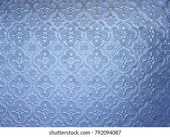 Pattern in blue glass