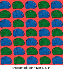 Pattern of blue and green slices of bread on red background.