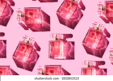 Pattern bottles of woman perfume on a pastel pink background, top view, flat lay. Mockup of pink fragrance perfume bottle mockup on pastel pink empty background