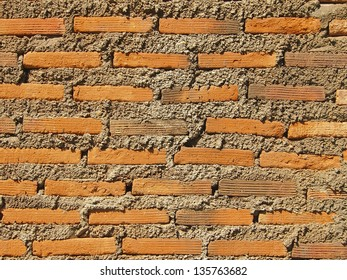 pattern of brick and concrete wall in sunlight