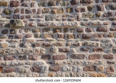 Pattern of bricks and stones at old middle age wall, Magdeburg, Germany, closeup, details