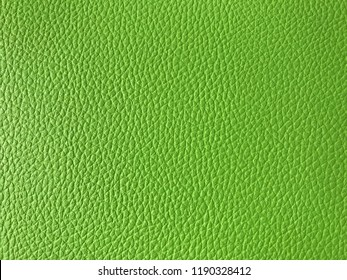 The pattern of bright green artificial leather,modern fake leather,background copy space for text.