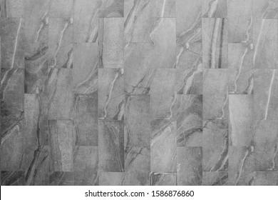 The pattern of building a block wall background. Slate tile ceramic/granite, seamless texture block dark gray.