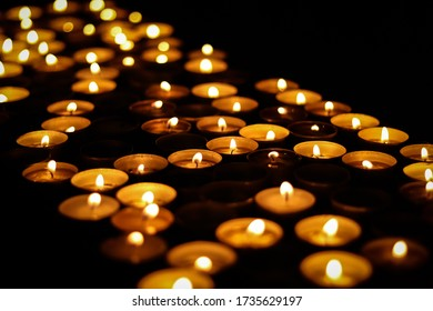 Pattern of burning candles in the dark