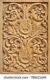 Pattern carved on wood background.