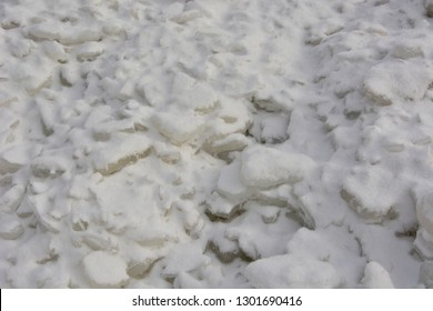 I pattern caused by the wave action of frozen Lake Michigan in the middle of winter making a background texture or pattern.