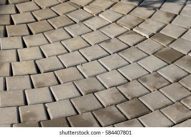 Pattern of cement brick floor in the public park.