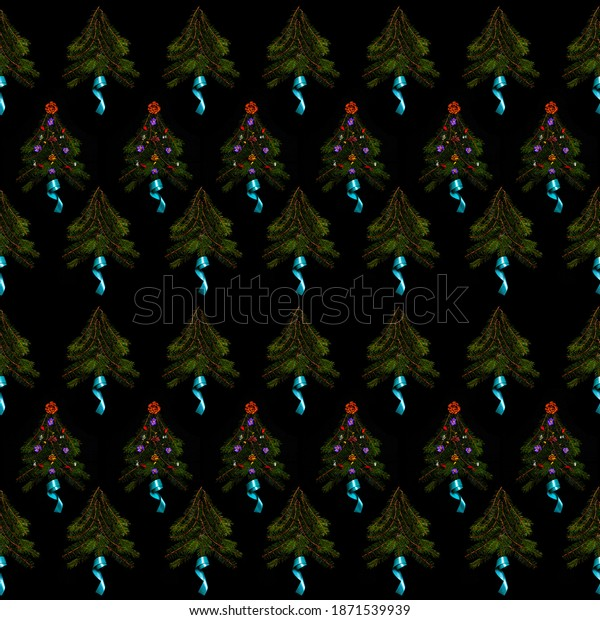 Pattern of Christmas trees on a black background, photography. Repeating elements of Christmas trees made of pine branches decorated with flowers. Organic and decorated. Selective focus.