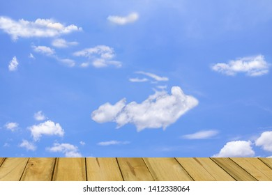 Pattern Cloud Against  Blue Sky and wood, copy space