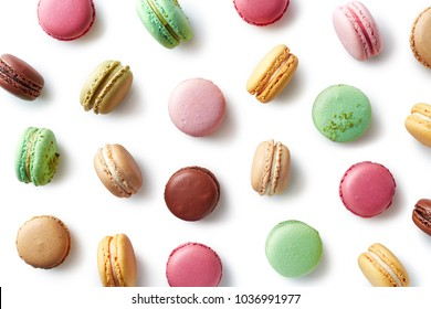 Pattern of colorful french macarons isolated on white background. Top view. Pastel colors