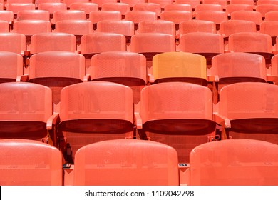 Pattern of colorful plastic stadium seats. Rows of empty chairs in a stadium as abstract background.