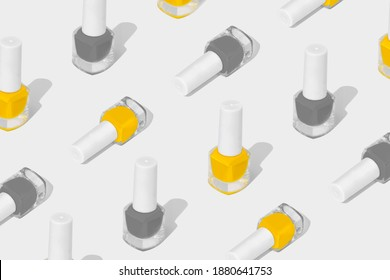 Pattern composition of nail polish on a white background. Colors of the year 2021. Set of shades of Illuminating and Ultimate Grey.