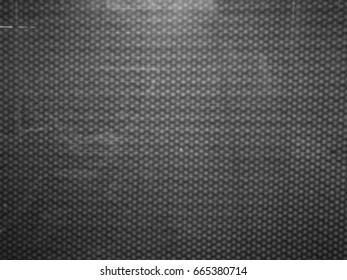 pattern consisting of squares on a grey background.Soft focus