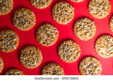 pattern of cookies on a red background, cookies with seeds