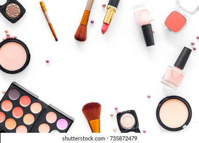 Pattern with cosmetics set with beige and nude colors on white background top view copyspace