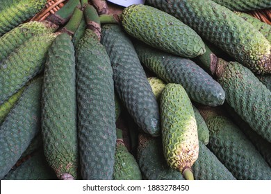 pattern created by a heap of green ripe monstera deliciosa fruits in the market