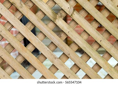 Pattern created by small wood stripes with quare holes in between
