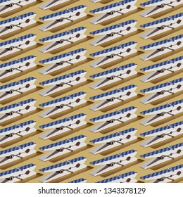 Pattern of dark blue polka-dots clothespins on pastel yellow background.