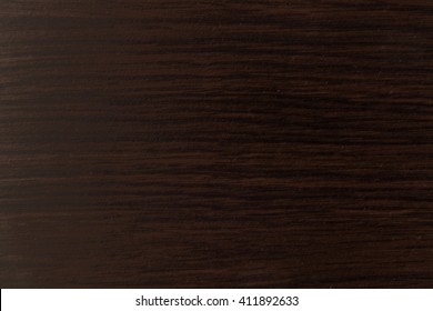 Pattern of dark wood. Lacquered wooden table surface texture.