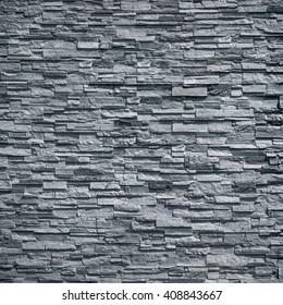 pattern of decorative black slate stone wall surface / black stone