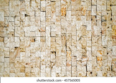 pattern of decorative brown grey slate stone wall surface, background, texture