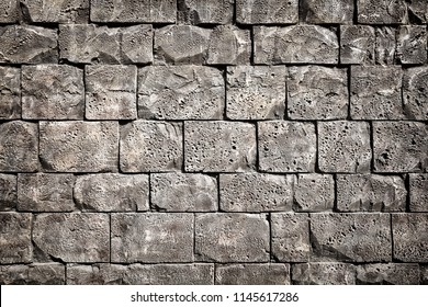 Pattern of decorative stone wall surface with cement.