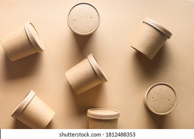 Pattern of eco-friendly disposable cardboard soup cups with shadow on brown paper background. Ecological individual package.