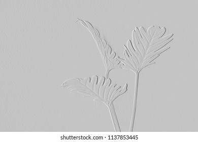 Pattern of embossed flowers on background grey