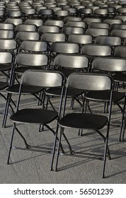 Pattern of empty black chair rows