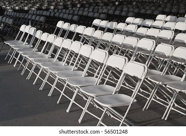 Pattern of empty white chair rows