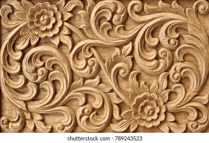 Pattern of flower carved on wood background.