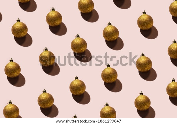 Pattern of gold Christmas tree ornaments. Gold Christmas toys. Image for Christmas and new year greeting cards. Image for designed packing, covers
