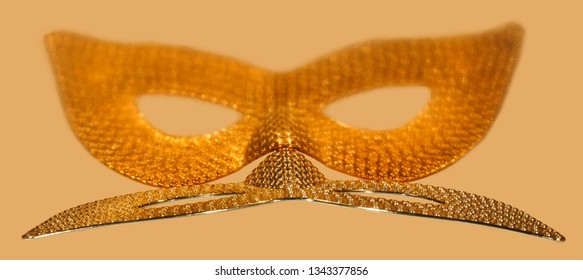 Pattern of golden eye masquerade on gold background.