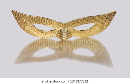 Pattern of golden eye masquerade on silver background.