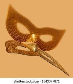 Pattern of golden eye masquerade on gold background.