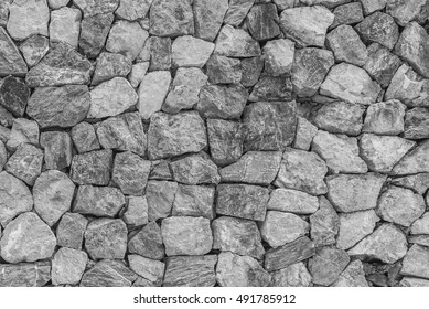 pattern gray color of modern style design decorative uneven cracked real stone wall surface with cement,stone wall, cracked stone wall background and texture,stone texture closeup wall