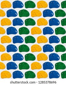 Pattern of green, blue and yellow slices of bread on white background.