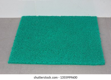 pattern of green rubber mat on the floor