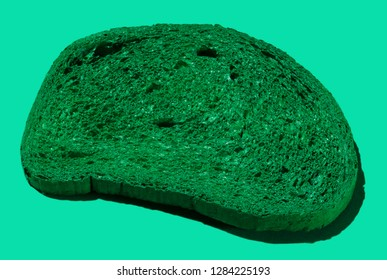 Pattern of green slices of bread on green background.