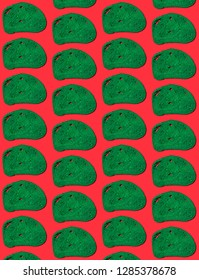 Pattern of green slices of bread on red background.