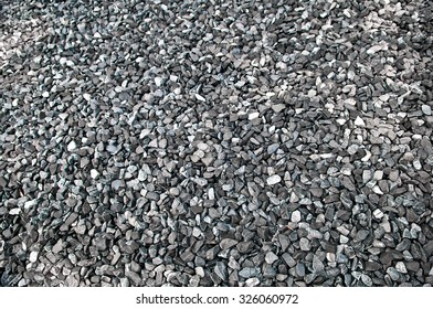 Pattern grey gravel stones on the floor or ground for background, low angle view.