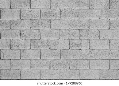 Pattern of grey wall made of concrete bricks