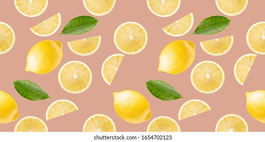 pattern with lemon slices and leaves on a light pink background