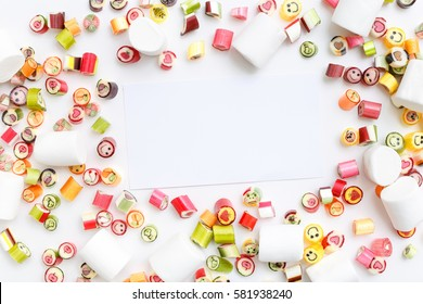 Pattern lollipops, candy on colorful white frame background, top view flat lay. Sweet sucker, lollipop, candy, isolated minimal concept above decoration, food background