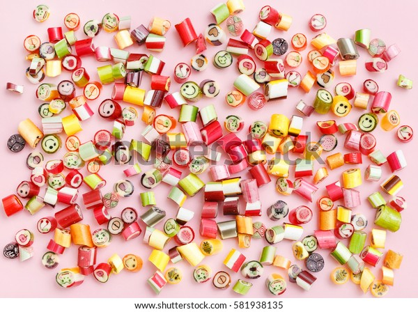 Pattern lollipops, candy on colorful pink background, top view flat lay. Sweet sucker, lollipop, candy, minimal concept above decoration, food background