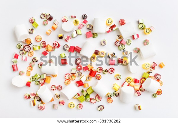 Pattern lollipops, candy on colorful white background, top view flat lay. Sweet sucker, lollipop, candy, isolated minimal concept above decoration, food background