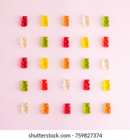 Pattern made of jelly bears on pink background. Flat lay. Minimal concept