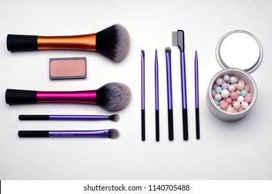 Pattern of make-up kit: brushes, meteorite powder and blusher
